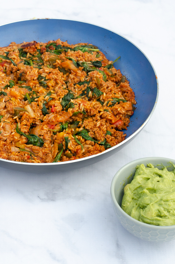 An incredibly simple and tasty Mexican rice casserole full of delicious peppers, onions, tomatoes, ground beef and of course, rice! Gluten-free, dairy-free and easy to make Paleo, low-carb and Whole30.