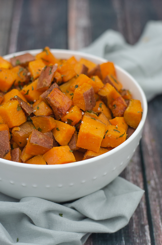 These roasted garlic sweet potatoes are sweet, salty and garlicky, the perfect side dish recipe! Paleo, Whole30, gluten-free, grain-free, dairy-free.